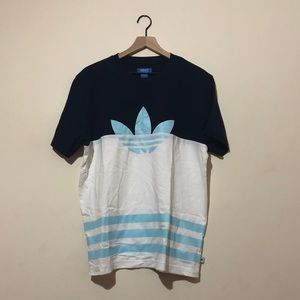 Adidas men's shirt in a navy blue and white color